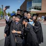 A group of degree candidates from the College of Liberal Arts & Sciences pose with Young-Chan Son, a lecturer in chemistry at the Avery Point Campus before their Commencement ceremony at Gampel Pavilion on May 10, 2015. (Peter Morenus/UConn Photo)