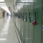 A row of lockers in an empty school hallway. (iStock Photo)