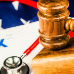 Photo illustration of gavel, stethoscope, prescription pad, and the American flag. (iStock Photo)
