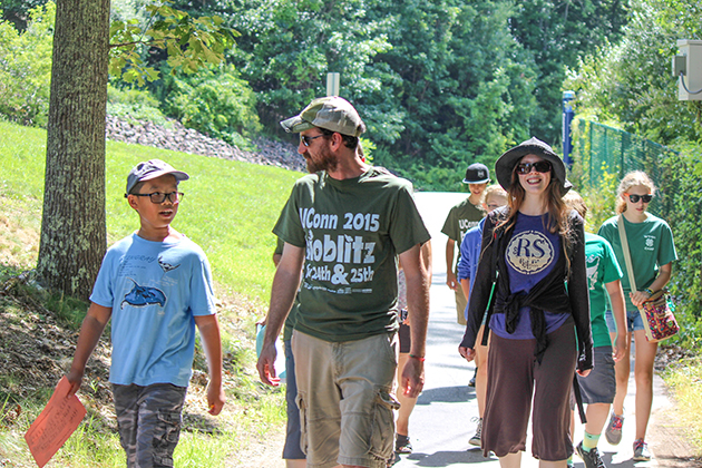 A group of BioBlitz participants and volunteers walk to the Hillside Environmental Education Park wetlands near North Campus on July 25. (Sheila Foran/UConn Photo)
