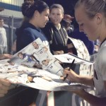 Rachel Hill, women's soccer, signs autographs. (Bret Eckhardt/UConn Photo)