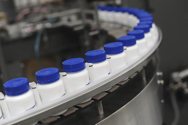 Pill bottles at a manufacturing plant. (iStock Photo)