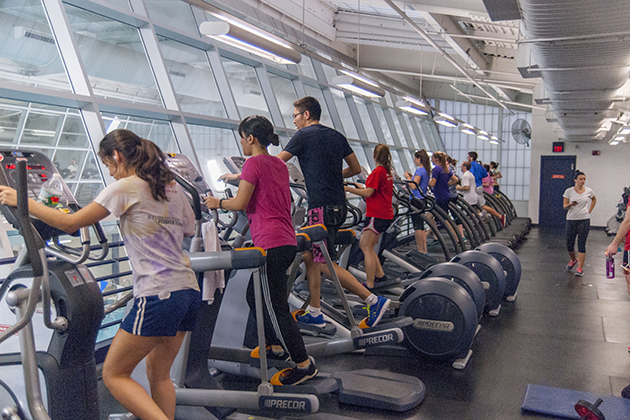 Students exercise at the current UConn recreation facility in Field House. (Jacquanna Wilson/UConn Photo)