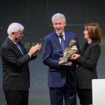 President Bill Clinton, center, receives an award from former Senator Christopher Dodd, left, and Helena Folks, chair of the national advisory board during the ceremony to award the Thomas J. Dodd Prize in International Justice and Human Rights held at the Jorgensen Center for the Performing Arts on Oct. 15, 2015. (Peter Morenus/UConn Photo)