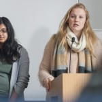 Anna Middendorf, right, gives a presentation during a human rights class taught by Professor Shareen Hertel in Oak Hall. (Sean Flynn/UConn Photo)