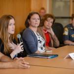 Erin Cox, an outreach coordinator and psychologist at Counseling and Mental Health Services speaks during a discussion on campus safety, emergency training and mental health issues held at the School of Business board room on Oct. 14, 2015. (Peter Morenus/UConn Photo)