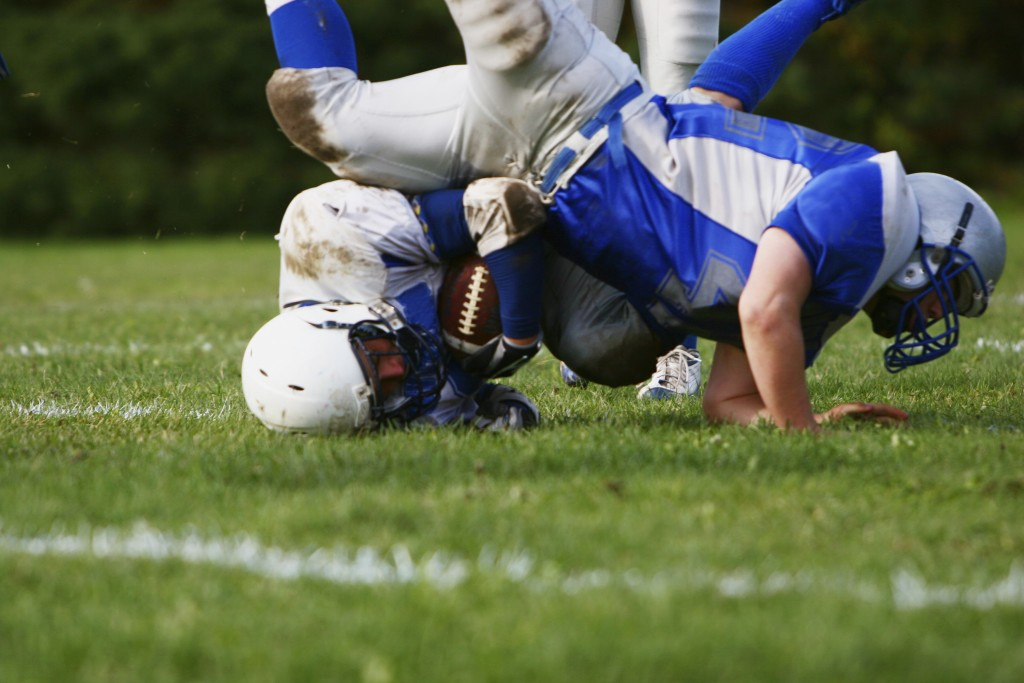 A football player falls head-first during a game. (iStock Photo)