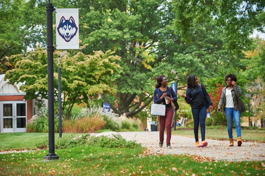 Students walk outdoors at the current Hartford campus. (Peter Morenus/UConn Photo)