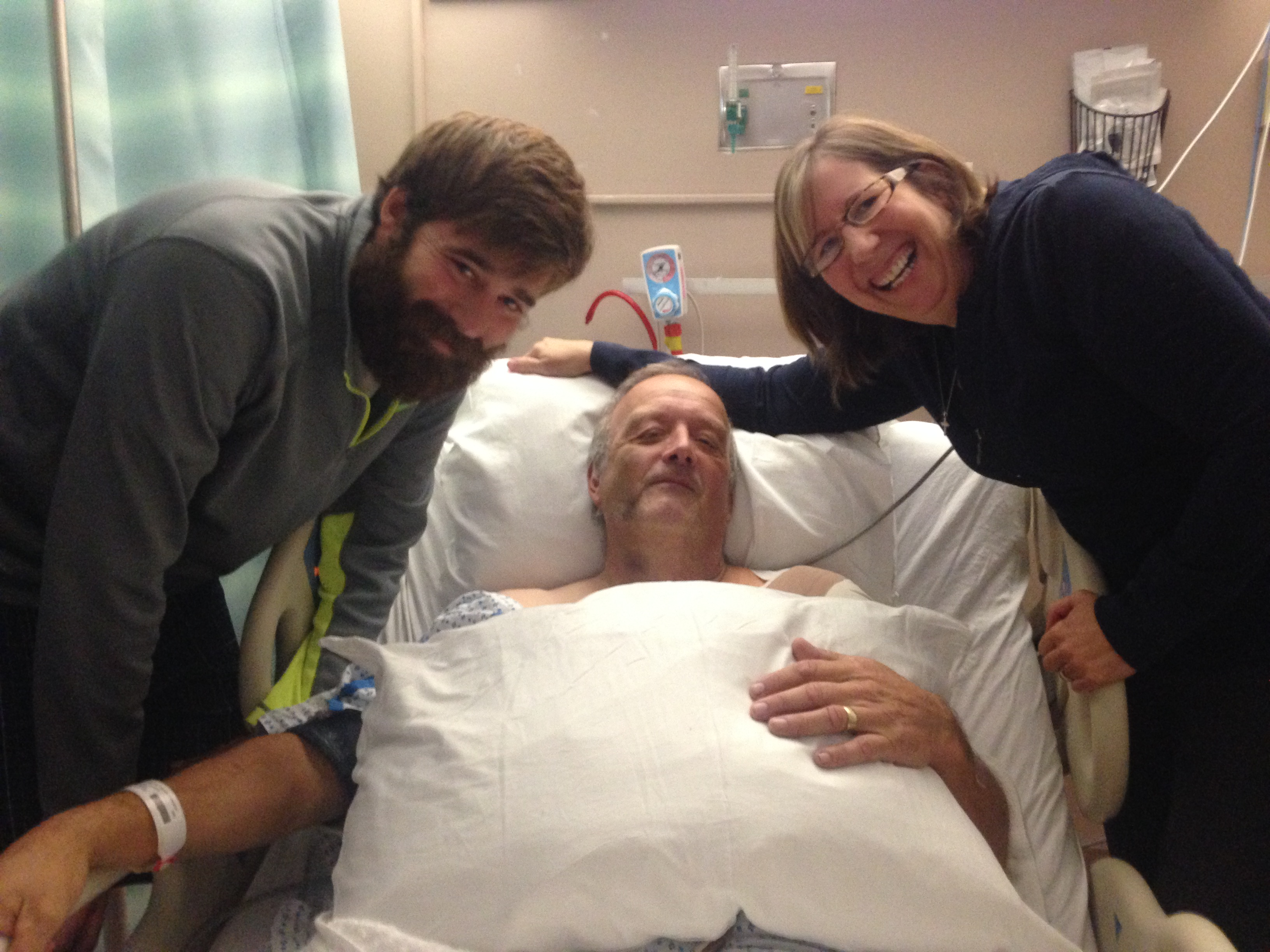 On the road to recovery, Lloyd ssssss with his son, Drew, and wife Debbie.