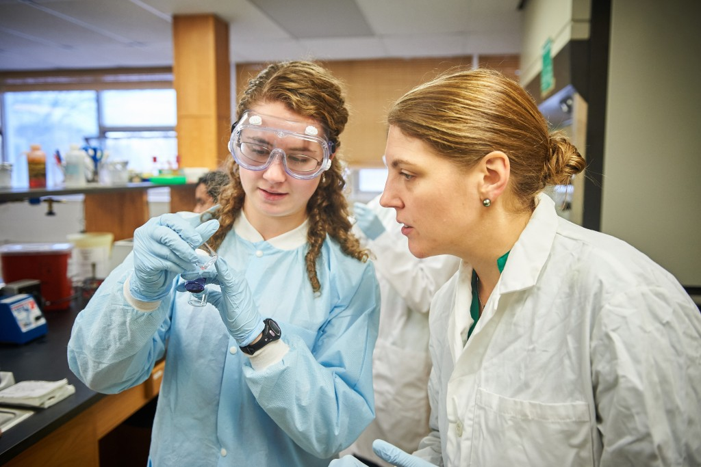Katherine Bell '19 (CLAS), left and Nichole Broderick, assistant professor of molecular and cell biology, looks at vials of collected bacteria in a microbiology lab at the Torrey Life Sciences Building on Nov. 10, 2015. (Peter Morenus/UConn Photo)