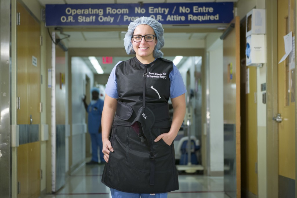 Orthopedic surgeon Tessa Balach stands in front of the OR hallway in the Bliss Building of Hartford Hospital. (Chris Rakoczy/Hartford HealthCare)