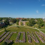 More than 3,000 members of the UConn Class of 2019, part of the University's largest-ever freshman class, pose for a photo on the Great Lawn at the Storrs Campus at the start of the academic year. (Peter Morenus/UConn Photo)