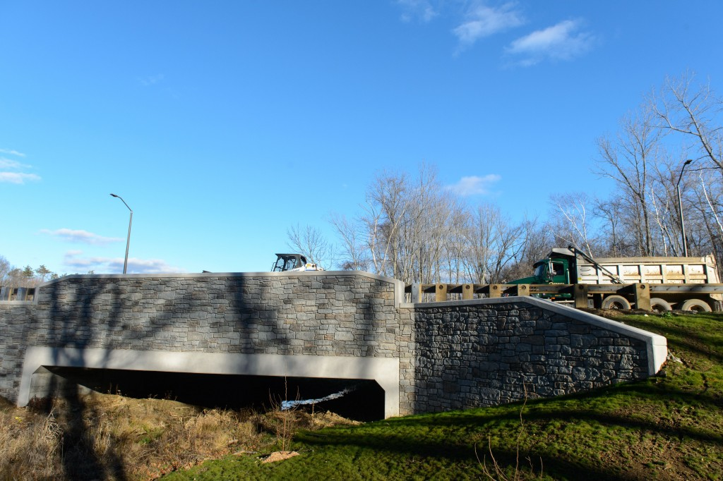 Large culverts under the bridges along Discovery Driveare designed to allow wildlife to pass under the new road. (Peter Morenus/UConn Photo)