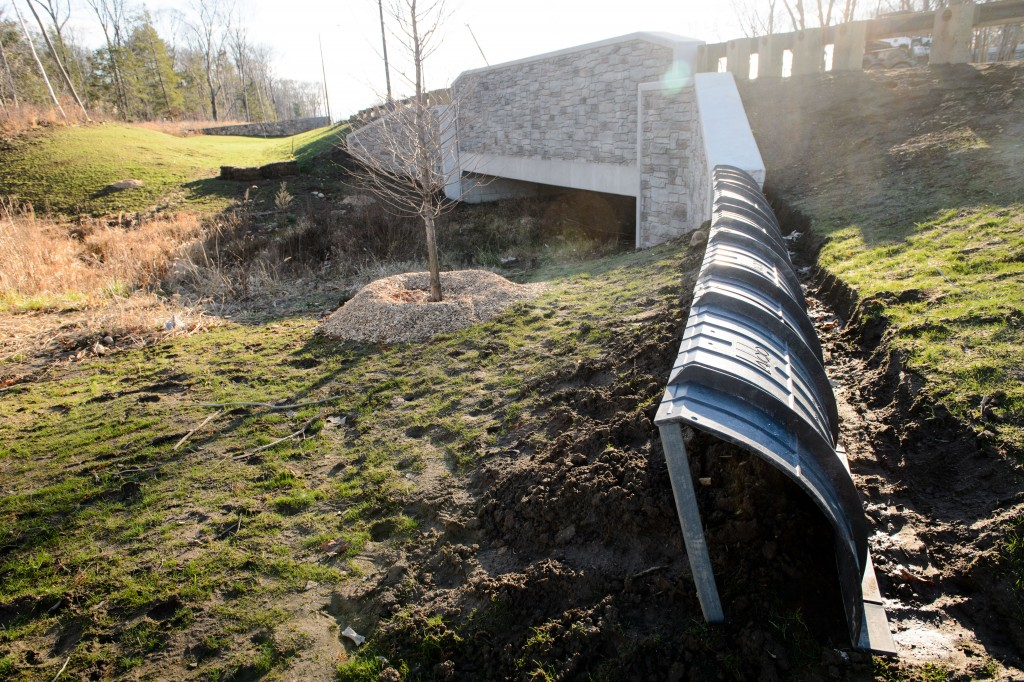 These curved amphibian barriers are being installed to direct wildlife under bridges along the completed Hillside Road extension. (Peter Morenus/UConn Photo)