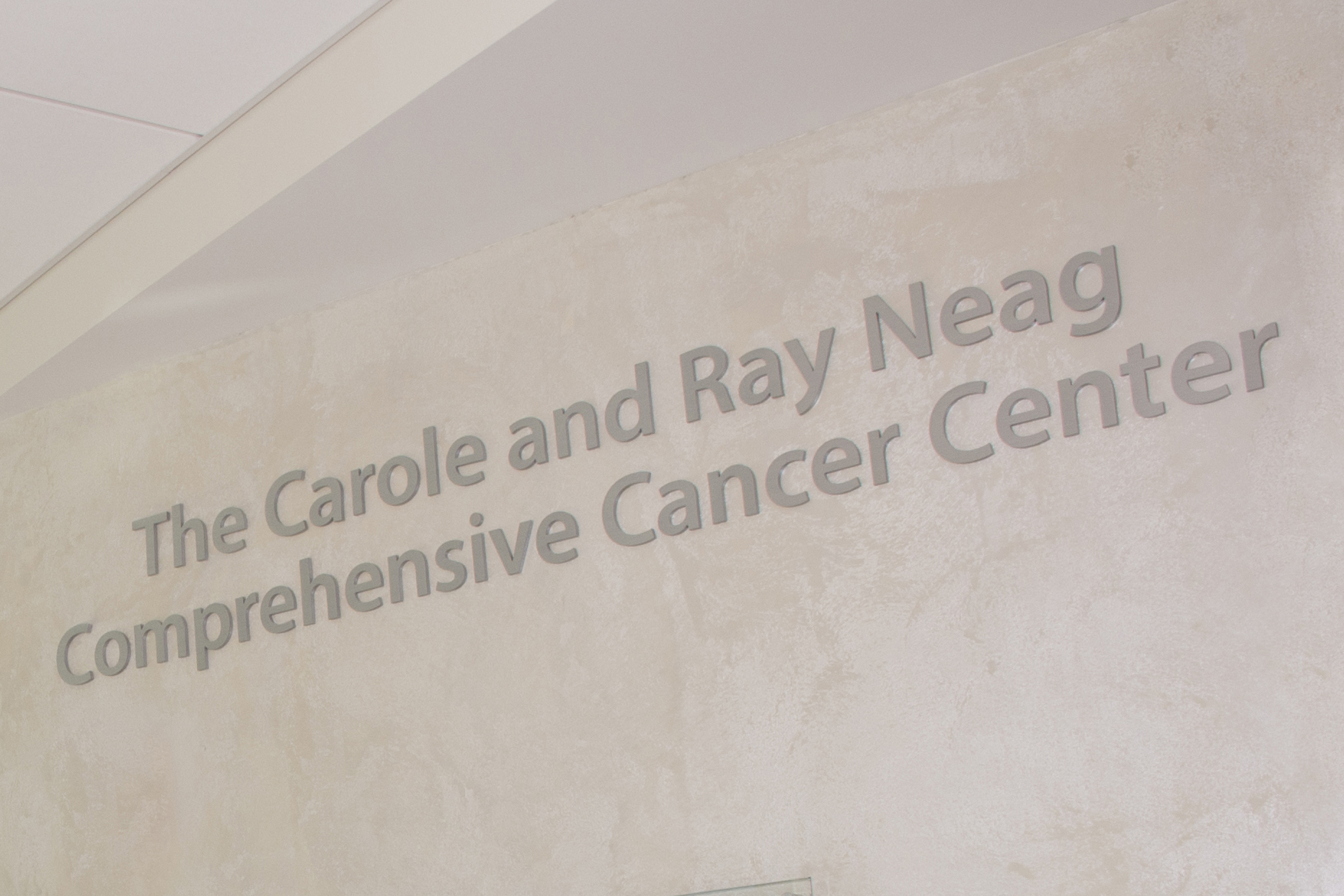 Sign at the entrance to the Carole and Ray Neag Cancer Center in the Outpatient Pavilion at UConn Health. (Janine Gelineau/UConn Health Photo)