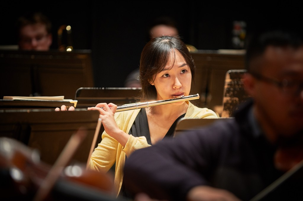 Graduate student Hyejin Bae plays flute during a rehearsal of the University Symphony Orchestra at von der Mehden Recital Hall on Nov. 16, 2015. (Peter Morenus/UConn Photo)