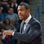 Men's basketball head coach Kevin Ollie coaches from the sidelines. (Stephen Slade '89 (SFA) for UConn)