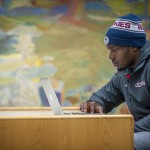 Student-athlete Nnamdi Amilo, men's basketball studying at the Homer Babbidge library on Jan. 26, 2016. (Sean Flynn/UConn Photo)