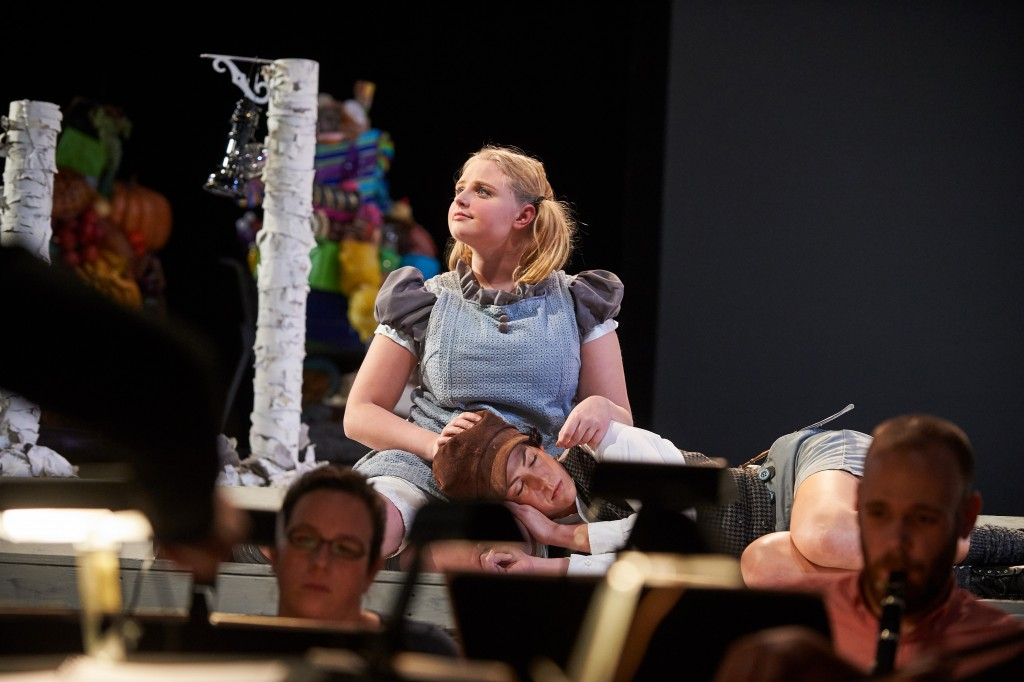 Katelyn Lewis '15 (SFA), seated, plays Gretel, and Caroline O'Dwyer '11 (SFA) Hansel, in UConn Opera's presentation of 'Hansel and Gretel' at the Jorgensen Center for the Performing Arts. (Peter Morenus/UConn Photo)