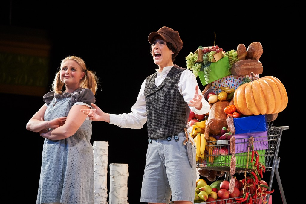 Katelyn Lewis '15 (SFA) as Gretel and Caroline O'Dwyer '11 (SFA) as Hansel stumble upon shopping carts filled with candy, fruit, and junk food. (Peter Morenus/UConn Photo)