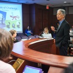 George Sugai, professor of educational psychology, speaks during a presentation on hands-off behavioral interventions held at the Legislative Office Building at the state capitol on Jan. 27, 2016. (Peter Morenus/UConn Photo)
