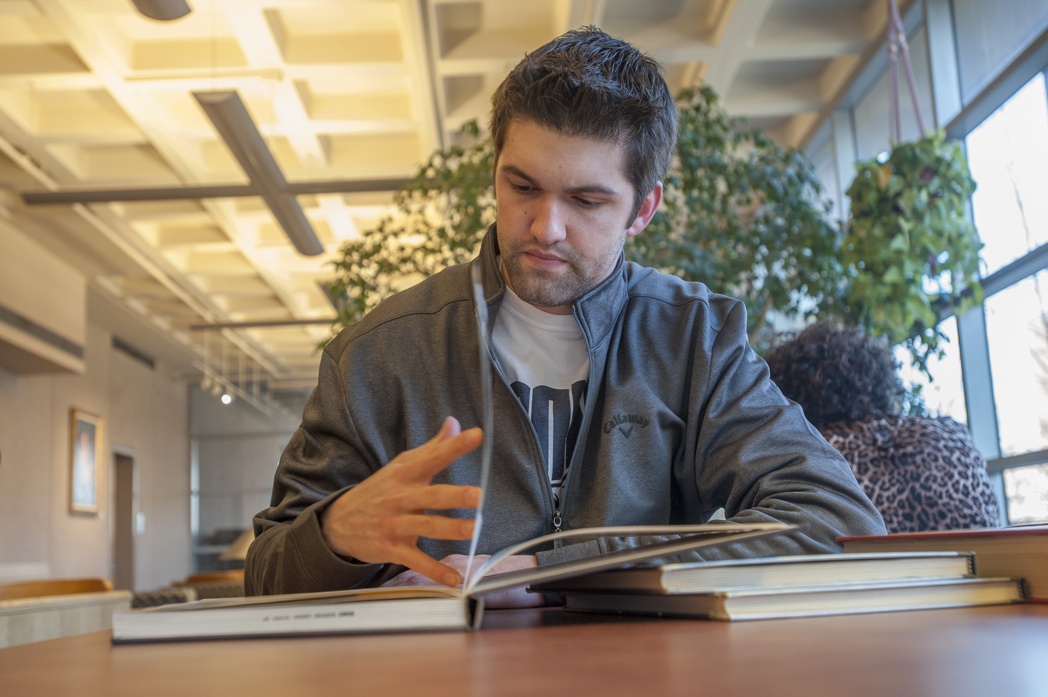 Student-athlete Kyle Huson studying at the Homer Babbidge Library on Jan. 12, 2016. (Sean Flynn/UConn Photo)