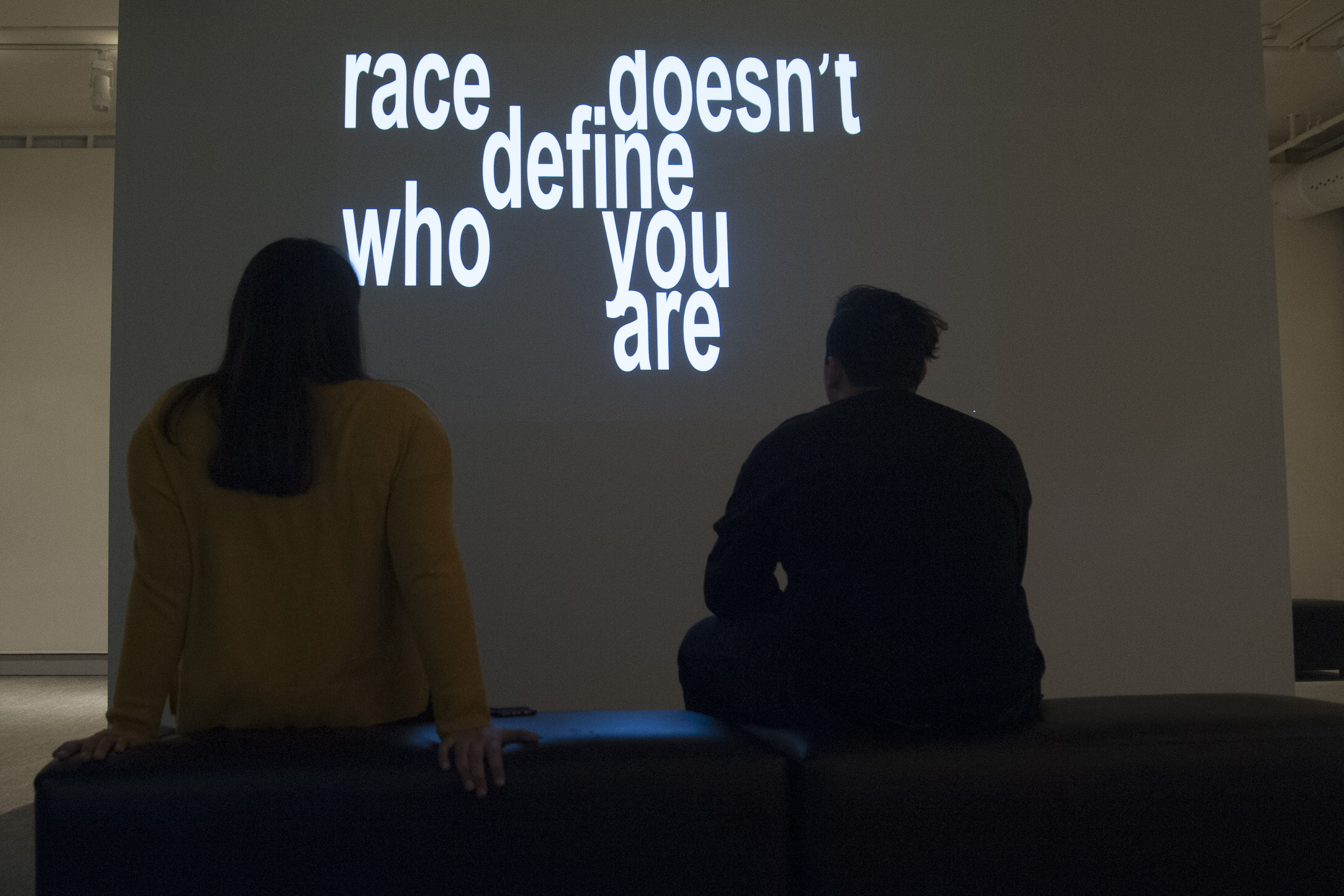 UConn Reads exhibit: works by graphic design students on the issue of race at the Benton on Jan. 22, 2016. (Sean Flynn/UConn Photo)