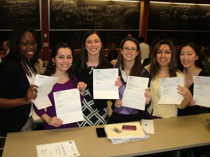2011: Fourth-year medical students, including Mona Shahriari (second from right), show their residency assignment letters on Match Day. (Photo submitted by Mona Shahriari)