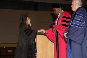 2011: UConn Board of Trustees Director Larry McHugh watches Dr. Cato Laurencin, dean of the UConn School of Medicine, congratulate Mona Shahriari at commencement. (Photo by John Atashian)