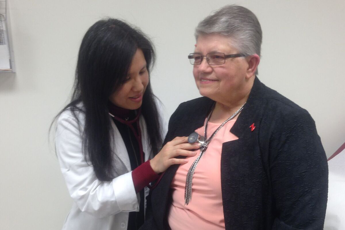 Cardiologist Dr. Joyce Meng, left, with heart attack survivor Cris Muscara. (Lauren Woods/UConn Health Photo)