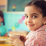 Children eating breakfast at school. (Shutterstock Photo)