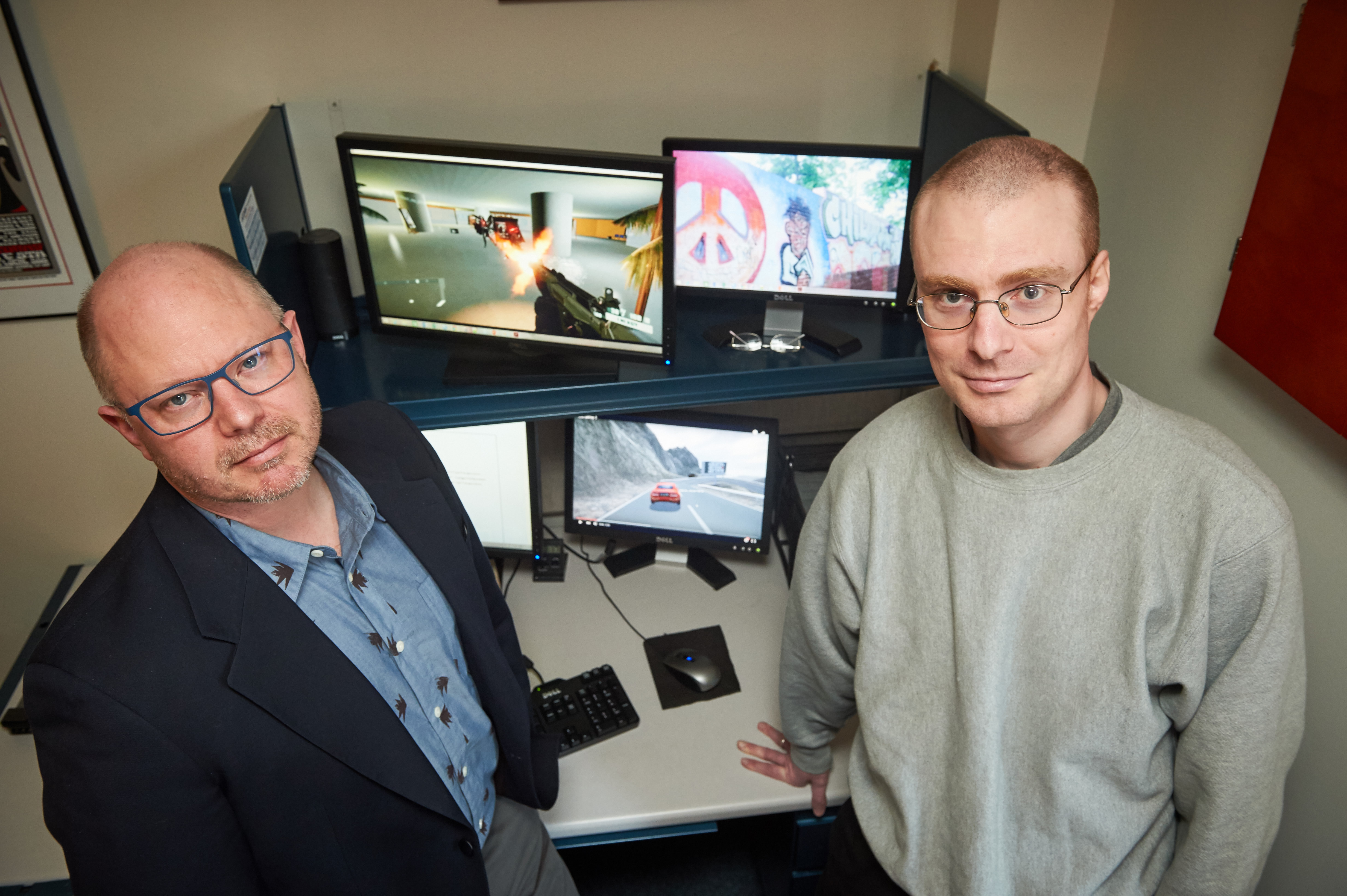 Hart Blanton, left, professor of psychology, and postdoc Chris Burrows '15 Ph.D. study video games with embedded health messages on March 9, 2016. (Peter Morenus/UConn Photo)