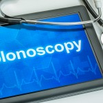 A tablet with the word colonoscopy, and a stethoscope. (Shutterstock Photo)
