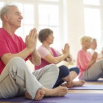 lder adults, both men and women, exercise together. (iStock Photo)