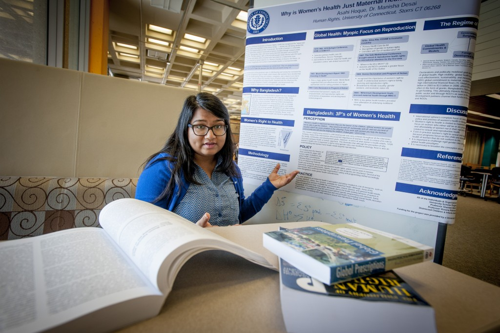 Asahi Hoque '16 (CLAS) presents a poster about her research on women's access to health care in Bangladesh. The research was funded with an IDEA grant. (Sean Flynn/UConn Photo)