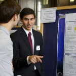 John Ovian '17 (CLAS) explains his research in chemistry to a fellow student at the 19th annual Frontiers in Undergraduate Research Poster Exhibition. (UConn Photo/Sydney Lauro '17 (CLAS))