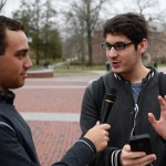 Ben Goldman '18 (CLAS) interviews students on camera about the last photo on their phone. (Ryan Glista '16 (CLAS)/UConn Photo)