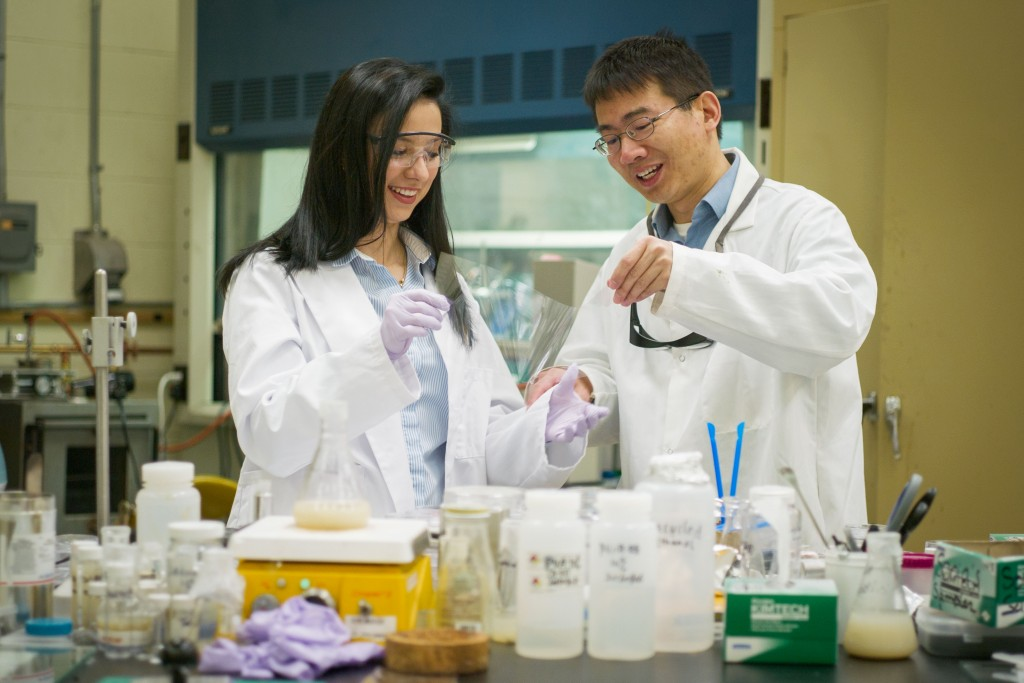 Ornella Tempo '16 (ENG) in the lab at the Institute for Materials Science with Luyi Sun, associate professor of biomolecular engineering, on April 25, 2016. (Peter Morenus/UConn Photo)