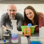 Kyle Baumbauer and Erin Young, at the Cell and Genome Sciences Building in Farmington on March 31, 2016. (Peter Morenus/UConn Photo)