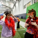 Raelene DeRobertis, left, and Teresa Barber-Tournaud, both from the Center for Clean Energy Engineering, dress up for a photo at the Mark R. Shenkman Training Center during the Employee Appreciation Day event on May 11, 2016. (Peter Morenus/UConn Photo)