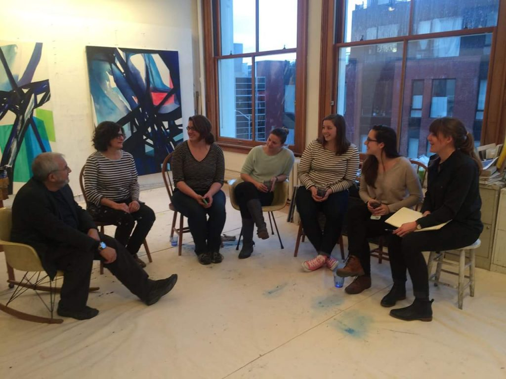 During New York's Armory Arts Week in early March, MFA students in Barry Rosenberg's graduate seminar visited artist studios, including the Brooklyn studio of abstract painter Laura Newman shown here. From left, Barry Rosenberg, Laura Newman, Erin Smith, Jelena Prljevic, Kaleigh Rusgrove, Claire Stankus, and Kelsey Miller. (Photo courtesy of students in ART 5310 Graduate Seminar)