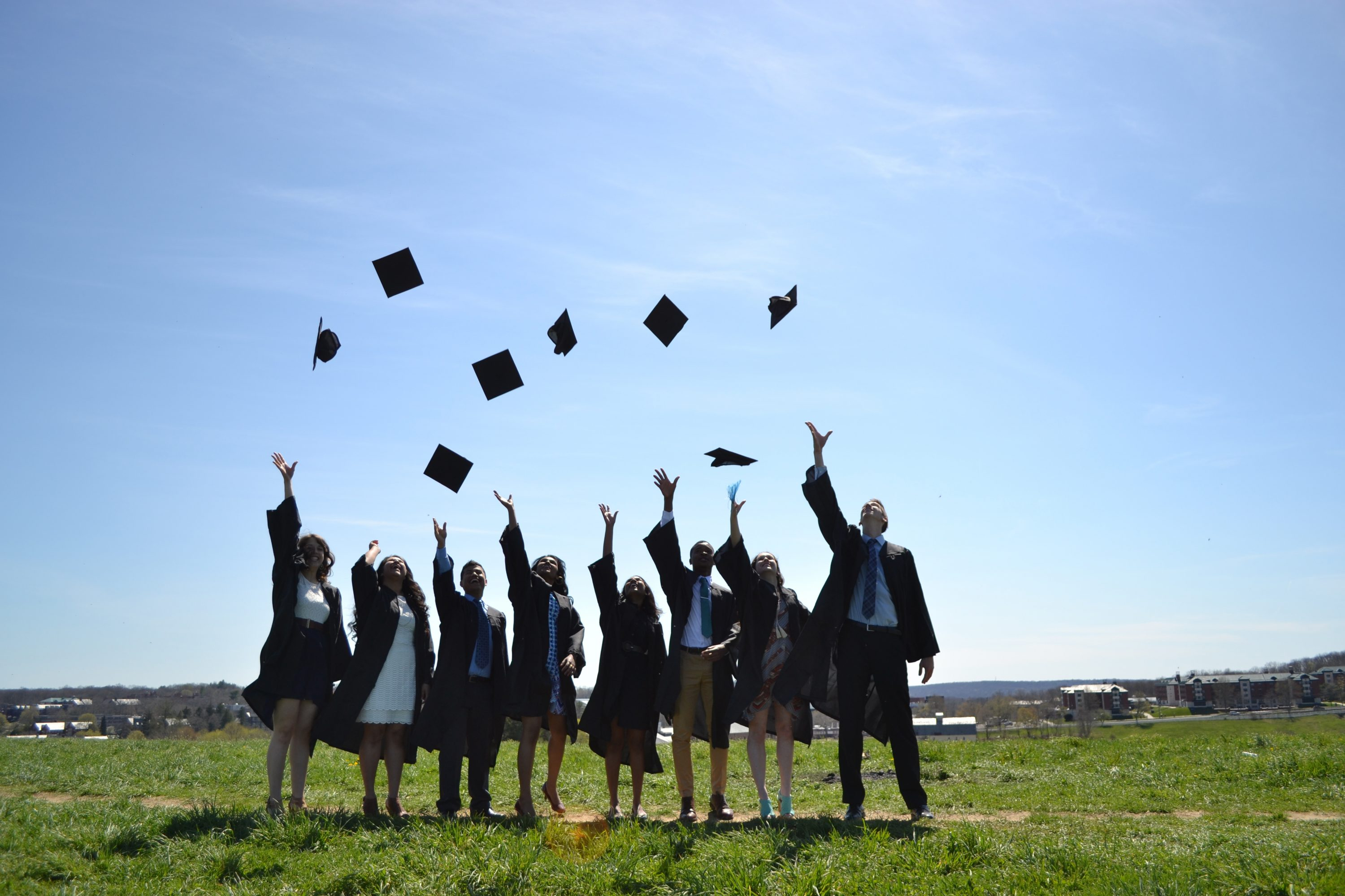 A group of seniors throw their caps in the air on top of Horsebarn Hill. (Gabriel Bachinelo '16 (BUS))