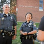 New UConn Police Officers Gary Bourgoin Susannah Hildebidle speak with students outside Oliver Ellsworth Hall on Aug. 28, 2015. (Peter Morenus/UConn Photo)