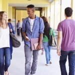 A group of high school students walking in a hallway. (iStock Photo)