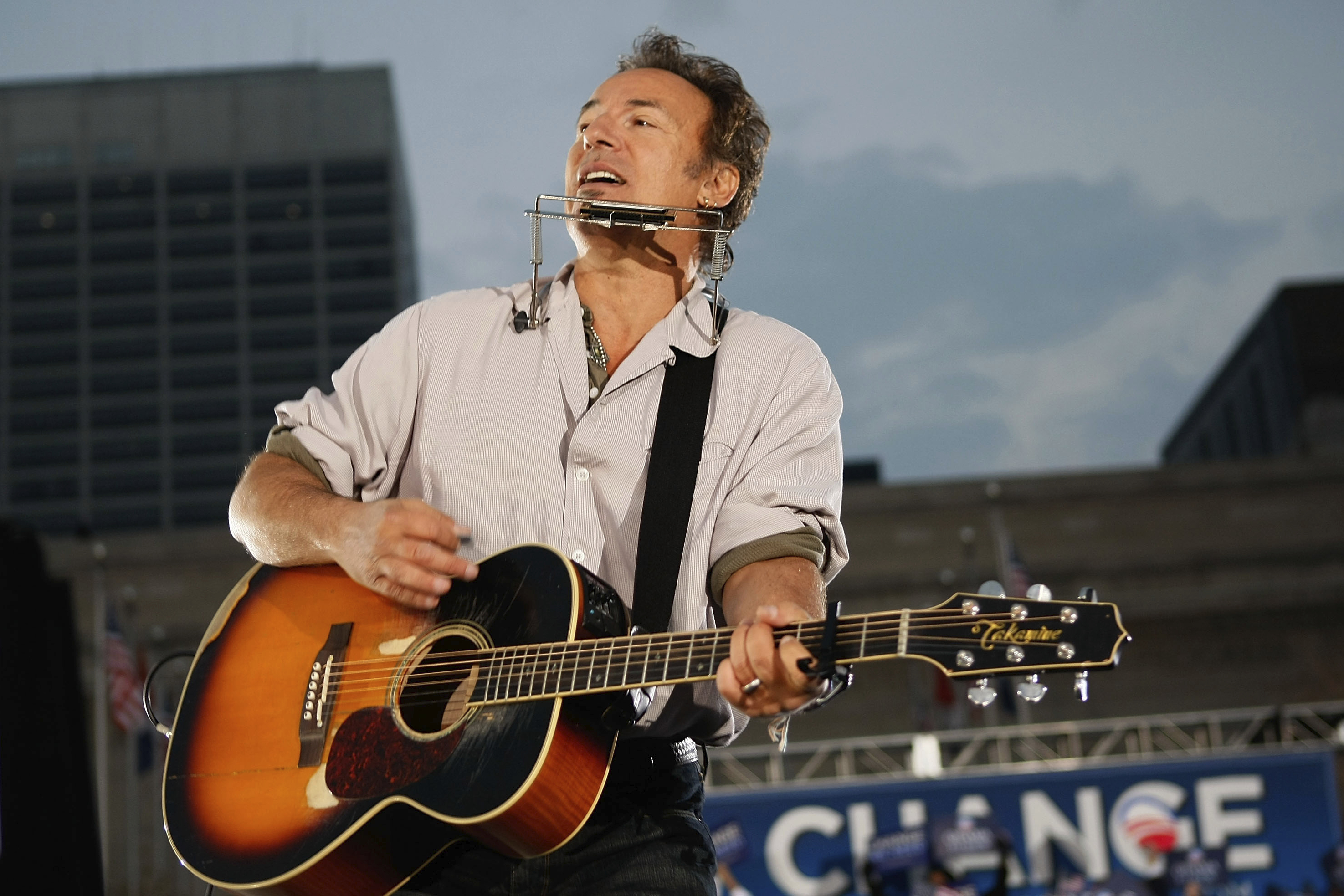 Singer Bruce Springsteen plays before Democratic presidential nominee U.S. Sen. Barack Obama (D-IL) takes the stage during a campaign rally at the Cleveland Mall November 2, 2008 in Cleveland, Ohio. Obama continues to campaign as Election Day begins to draw near as he runs against his Republican challenger, Sen. John McCain. (Photo by Joe Raedle/Getty Images)