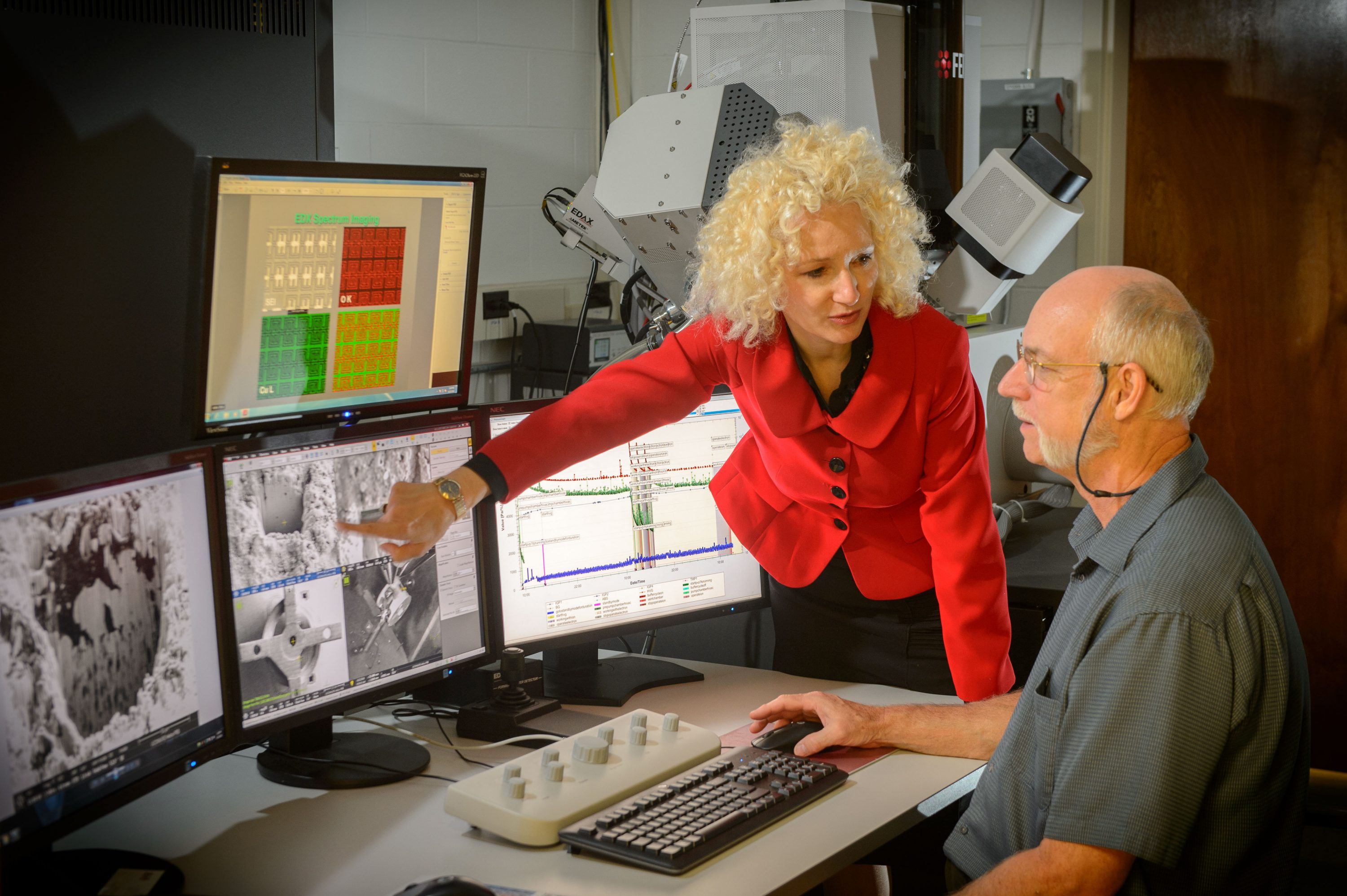 Radenka Maric, executive director of Tech Park, speaks with Roger Ristau, manager of the UConn-FEI Center for Advanced Microscopy and Materials Analysis. (Peter Morenus/UConn Photo)