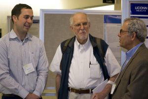 From left, fifth-year PhD student Spenser Smith talking with former SCOB director William Upholt and Jon Goldberg, the programs co-director. (Photo by Tina Encarnacion)