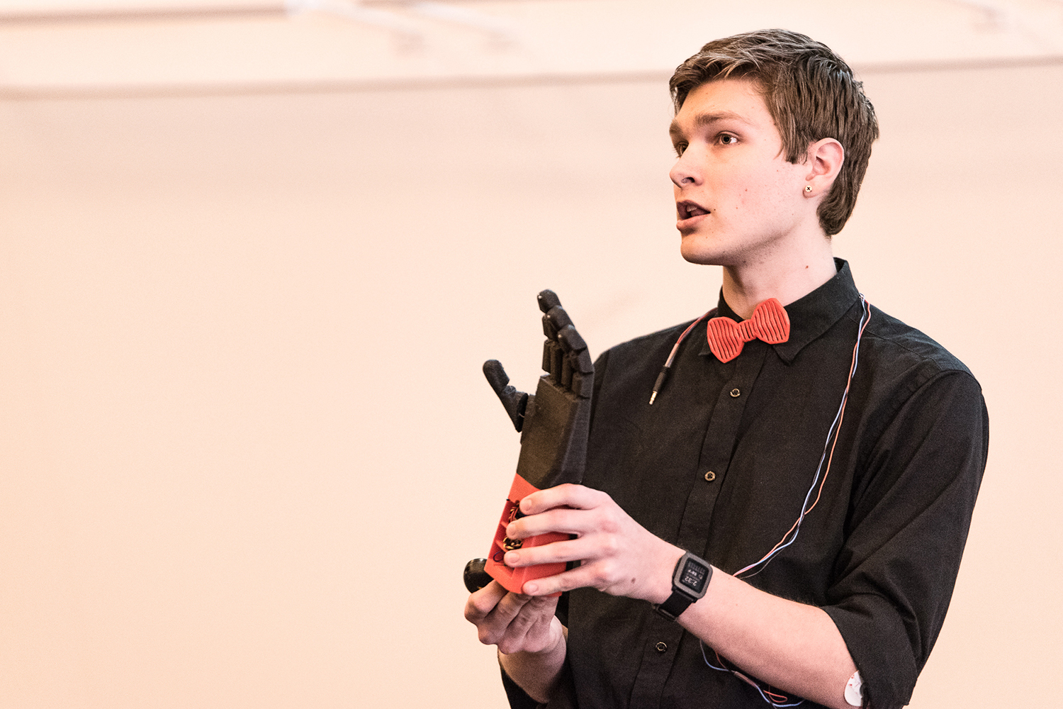 Stephen Hawes demonstrates the Atlas Arm: an inexpensive, 3D-printed prosthetic hand. (Nathan Oldham/UConn photo)