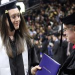 Breanna Stewart '16 (CLAS) receives her diploma during Commencement this past May. (Bob Stowell for UConn)