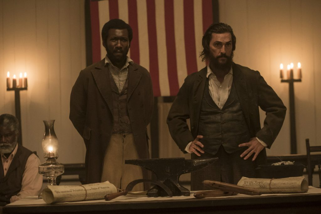 Moses (Mahershala Ali), left, and Newt (Matthew McConaughey) in a scene from 'Free State of Jones,' which is now showing in movie theaters. Sociologist Matthew Hughey describes such films as 'hegemonic.' (Promotional photo from the 'Free State of Jones' official website)